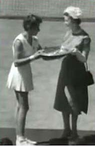 Maria Bueno accepts the Wimbledon trophy from HRH Princes Marina in 1959