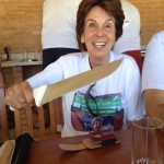 Maria gets her hands on one of the long knives at the Churrasco