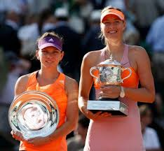 Simona Halep and Maria Sharapova show their respective trophies in Paris